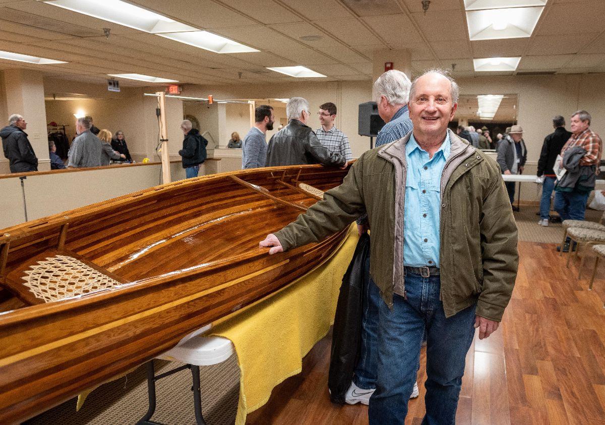 Wayne Meglan with his hand-built canoe